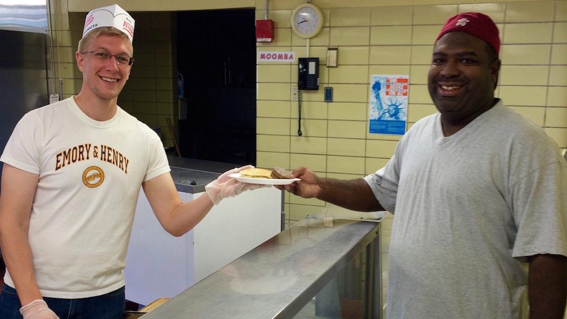 Photo op serving pancakes for teachers' appreciation breakfast